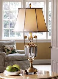 classic room decor with solid crystal table lamp with greek urn motif on the marble top table