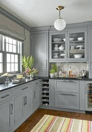 gray kitchen cabinets colorful stripes carpet round white and gold hanging lamp up down curtain light grey with dark countertops