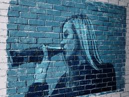 brick wall graffiti portrait by horobets