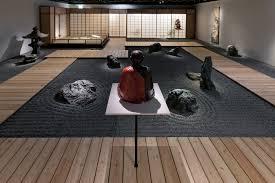 abstract zen garden wereldmuseum rotterdam materials natural green schist stones water basin granite gravel raked in patterns wooden flooring and a