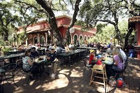 la hacienda features a patio that sits under large oak