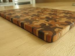 picture of end grain cutting board using mc escher tesations