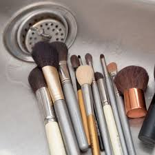 oils and bacteria trapped in the bristles of the brushes causing bacteria to grow the aculation of and the bacteria also makes the makeup go
