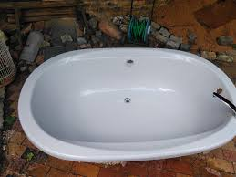 secondhand bathtub and vanity