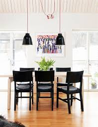 black caravaggio pendants and ikea chairs in dining room