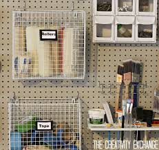 diy garage pegboard storage wall using only inches of pegboard garage wall ideas