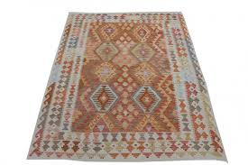 whereas in kilims both the warps and wefts are interwoven to each other in order to create a flat weave