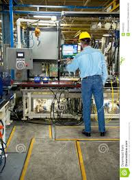 man working in industrial manufacturing factory stock photography man working in industrial manufacturing factory