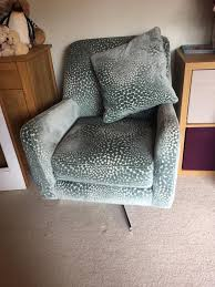 sophia patterned swivel chair from dfs 150