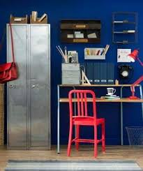 red home office. home office space with navy walls and red accents