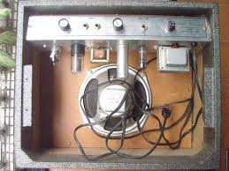 doing a 3 wire mains cable conversion on a vintage silvertone 1481 next step is to remove the metal enclosure from the wooden case to do this we remove four screws