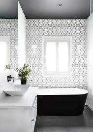 minimalist monochrome bathtub with black tub