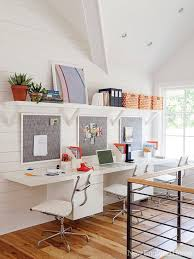 the upper shelving and long desk makes great use of a small space and the separate pin boards for art projects would be fun new england home gorgeous