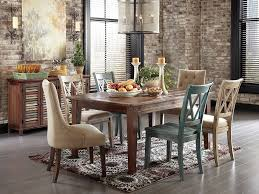 kitchen table with food. Dinner Table Centerpieces Completed With Candle Decorations Plus Food And Fruits Bucket On The Rustic Wood Dining Chairs In Beautiful Kitchen