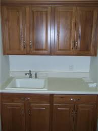hickory cabinets laminate countertop drop in utility sink