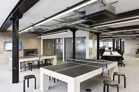 the furniture and layout is designed so that it will allow different types of spontaneous meetings to happen there are large communal office tables architecture office furniture