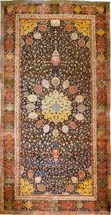 ardabil carpet at the v a inscription at the top of the field close to the border