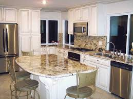 this kitchen features granite countertops with matching granite backsplashes the limited space allows for use