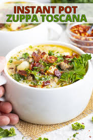 soup is a copycat recipe of the favorite olive garden classic this zuppa toscana recipe is made in the instant pot and is a healthy gluten free