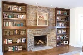 square wall mount electric fireplace with brown wooden floating shelves beside