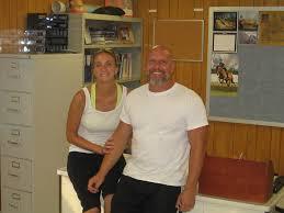 Dan and Kara Burr   Sitting at his desk in the classroom.   Jason ...