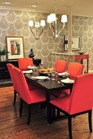 red upholstered dining room chairs modern graphic gray wallpaper