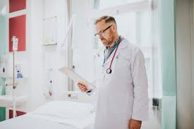 Reading Health Chart Doctor Reading A Patients Medical Chart Photo Premium Download