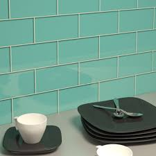 teal colored glass subway tile