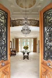 luxury entryway decors with glass chandelier over antique foyer table as well as great half glass swing entry door designs