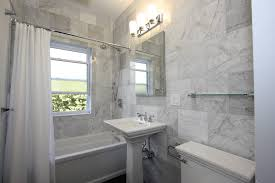 pretty kohler tub in bathroom eclectic with no grout shower next to tile around window alongside bianco venatino marble and marble bathroom