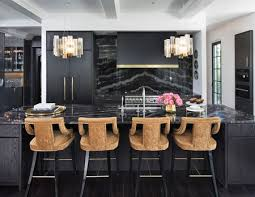 chic kitchen with black marble countertops