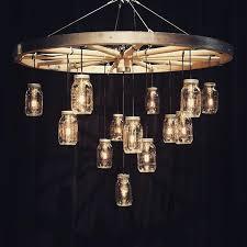 25 best wagon wheel chandelier ideas on wagon wheel intended for awesome property wagon wheel chandeliers plan