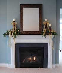 wonderful mantel decorating design ideas for white fireplace with wood candle holder rectangular wood framed wall mirror and gold ribbon for candle holder
