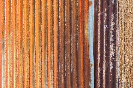 rusty corrugated iron metal fence zinc wall texture background stock photo