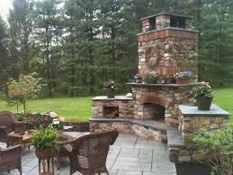 breathtaking outdoor wood burning fireplace design inspiration with brick chimney and relaxing living area in home patio