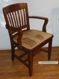 wooden chairs with arms.  Chairs Furniture Classic Wood Arm Chairs With Stripes Padded Seat And Cozy  Wooden Regard To 10 On Arms P