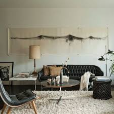 neutral style living room decoratin ideas with black leather sofa