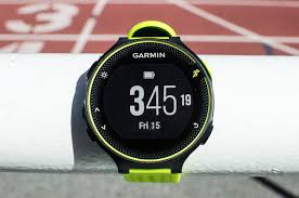 the best gps running watch the sweethome closeup photo of the face of a black and yellow garmin forerunner 230 gps running watch