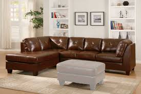 brown leather sectional sofa with white ottoman and