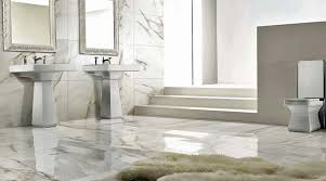 White Carrara marble tiles work well with this elegant period bathroom. The  tiles are actually ultra-thin large format porcelain by Porcel-Thin.