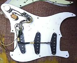 vintage guitars info fender collecting vintage guitars fender shielding plate around the pots and the white single layer pickguard at the top edge is a early 1960 s three layer celluliod mint green pickguard