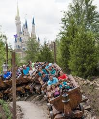 disneyland canadian resident ticket offer people riding the seven dwarfs mine train with cinderella s castle