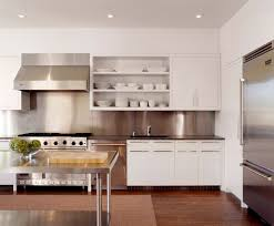 view in gallery sleek white dishes on open shelving in a white kitchen