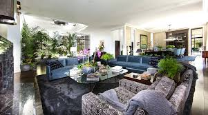 appealing art deco living room furniture featuring glass coffee table with metal legs and blue velvet colored sofa