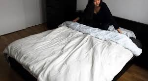 begin rolling both fabrics like a burrito as you roll the duvet itself will encircle the fluffy comforter