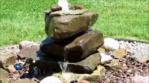 natural stone lighted fountain 1250gph with atlantic pondless basin