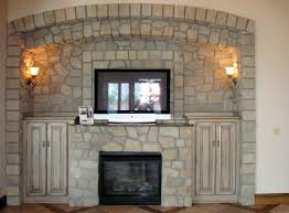 brilliant stone interior cream stone fireplace mantel between storage plus lamps with television on the middle inside stone fireplace mantel with tv a