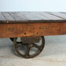 cozy antique vintage luggage cart coffee table circa 1920 with cast
