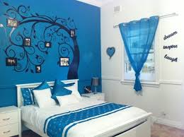 blue kids bedroom design ideas black tree wall decal blue fabric window curtain white wood end