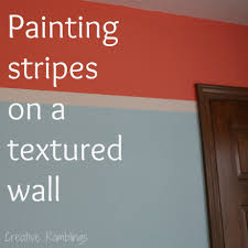 painting stripes on a textured wall